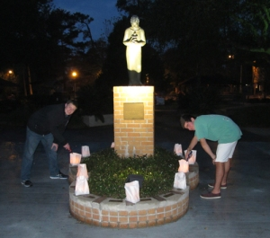 After luminaria bags are placed around campus, the candles are lit at dusk.