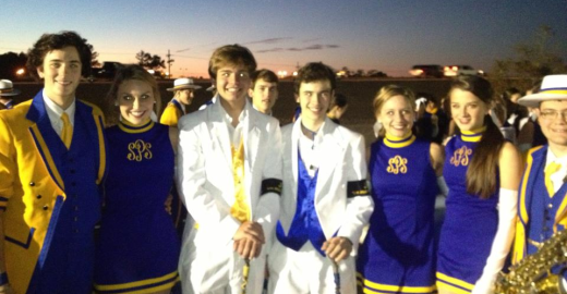 Marching Wolves and Golden Blues members prepare to line up for the Krewe of Eve parade.