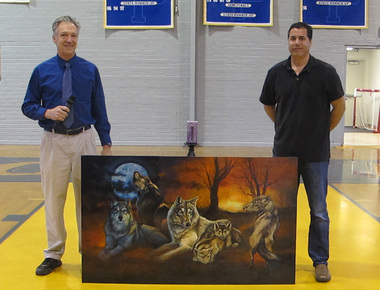 Biology instructor John Carambat and generous donor Kraig Schexnayder pose with the lastest addition of art to the St. Paul's campus.