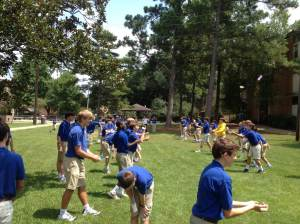 The new eighth graders enjoy a nice game of water balloon toss at the Five Core Rally.