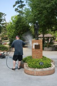 A parent cleaning up the campus after the vandalism. (Photo courtesy of The Covington Police Department)