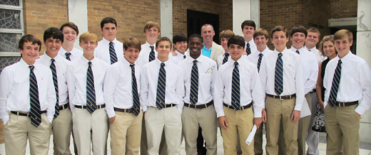 Students posing in their dress uniform shirts and ties.