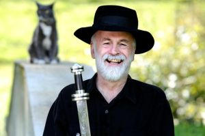 Sir Terry Pratchett wields his very own hand-forged meteorite sword.