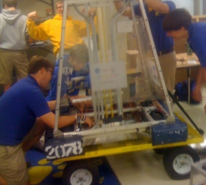 The team enjoying working hard on their robot.