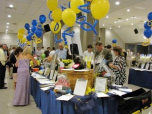 Event goers peruse the silent auction tables. (photo by Danielle Lavie)