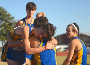 Brothers Zach and Spencer Albright embrace following the race.