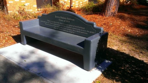 A bench bearing one of Justin's favorite quotes sits near the chapel as a memorial. (photo by Kole Gorney)