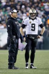 Saints coach Sean Payton and Drew Brees talking after a Brees interception. (photo by Matt Rourke)