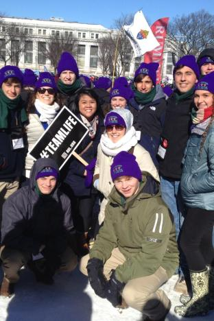 Purple hatted participants from the Arch-Diocese prepare for the March.  SPS students depicted, top L toR, senior Christian Caragliano, senior Michael Brown, senior Jacob McWilliams, senior Thomas Huval, and senior Michael Stewart, bottom L to R, freshman George Lee, senior Ben Kenney. Photo by Liz Carter.