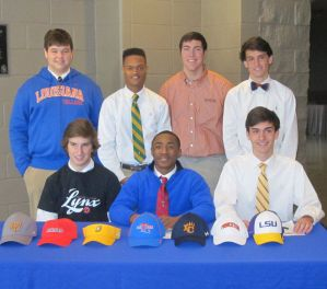 (Top) Tanner Steward, Mitch Brumfield, Andre Marshall, and Zachary Albright and (Bottom) John Frey, Marcus Gaines, and Don Lipani display their new colors after the signing ceremony. (photo by Karen Hebert)