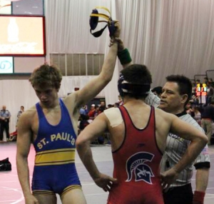 Senior Chris Meraux wins a tough match at state, placing 5th in his weight class. (photo from the SPS Wrestling facebook page).