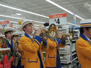 Drew Bratschi plays his horn at Walmart's parade for special needs children in 2014.