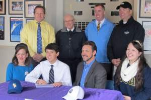 Senior Captain Thomas Ruli on signing day signing his papers to play golf for Spring Hill