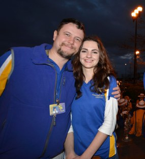 SPS Band Director and his wife, Ukrainian native Yana Obolenskaya, prepare to take the Marching Wolves through the streets of New Orleans for the Bacchus parade. (photo by Nary Cannon)