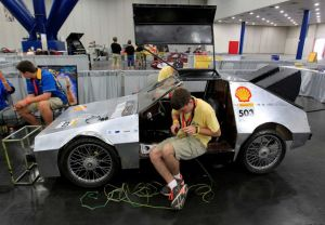 Marcus Garner works on the turn signals on the DeLoreon at the Houston Events