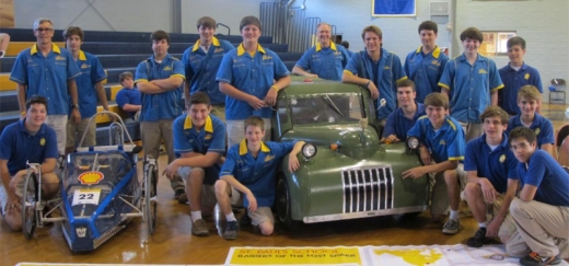 Eco-Car Club members pose with their creations at a school assembly following the Shell Eco-Marathon competition in Houston (photo by Danielle Lavie)