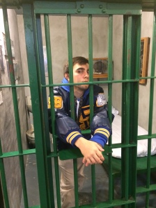 Trey posed in a cell while covering the junior class trip to the Louisiana State Penitentiary for The Paper Wolf.     (photo by Josh Nunez)