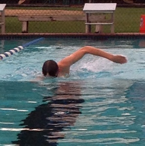 Tri-captain William Munn works on perfecting his freestyle stroke at a recent practice. (photo: Turner St. Romain)