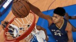Anthony Davis, star Power Forward for the New Orleans Pelicans, goes for a slam dunk in NBA 2K15. (Photo Credit: Operation Sports ©2K Sports)