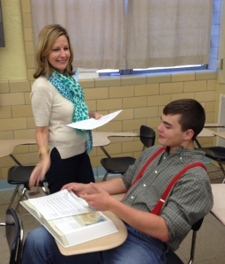 Gardner hands out a unit lesson plan to Matthew Melancon in AP US History.  (Photo By: Adam Satterlee)