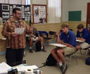 Guillory explains rhetorical devices to one of his AP Writing classes.   (Photo By: Adam Satterlee)