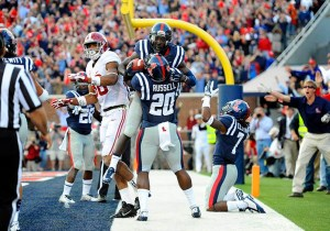 Ole Miss Rebel players celebrating Senquez Golson's interception to seal the Rebel victory. (Photo Credit: USA Today Sports)