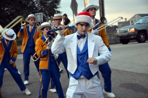 Senior Drum Major Lane Sumrall leads the band during the Madisonville Christmas Parade in December. (Photo by Andrew Moran)