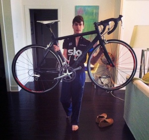 Rusty shows off his bike prior to his accident. He anxiously awaits his return to cycling. (photo courtesy Zac Russ)