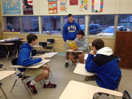 Luke Avenel and Matt Melancon ask questions from a Quiz Bowl book. Ethan Desforges and Alex Oliveri are poised to buzz in. (Photo By Adam Satterlee)