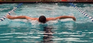 Jack Dubriel warms up with a breast stroke at practice. (photo by Turner St. Romain)