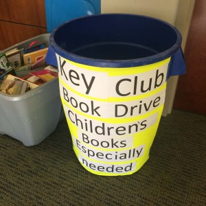 Collection bins for the Key Club children's book drive currently sit in various locations on campus. (photo by Ealon Boudreaux)