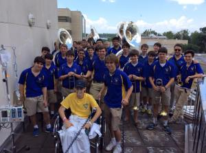 Members of the Marching Wolves visit Junior Drum Major Ruston Keller at Ochsner Hospital over the summer. The band performed for Ruston in a show of support for his second surgery to take place the following day. He has since had a third surgery and has one more left to go. (photo courtesy Marching Wolves)