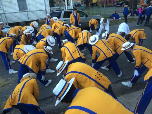 The St. Paul's Marching Wolves stretch before marching in a Mardi Gras parade to get prepared. (Photo by Christi Simoneaux)