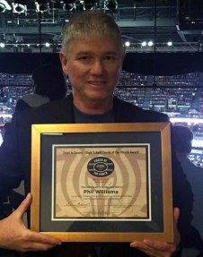 Head coach Phil Williams receiving an award from the Pelicans for coach of the month (courtesy of the SPS basketball twitter page)