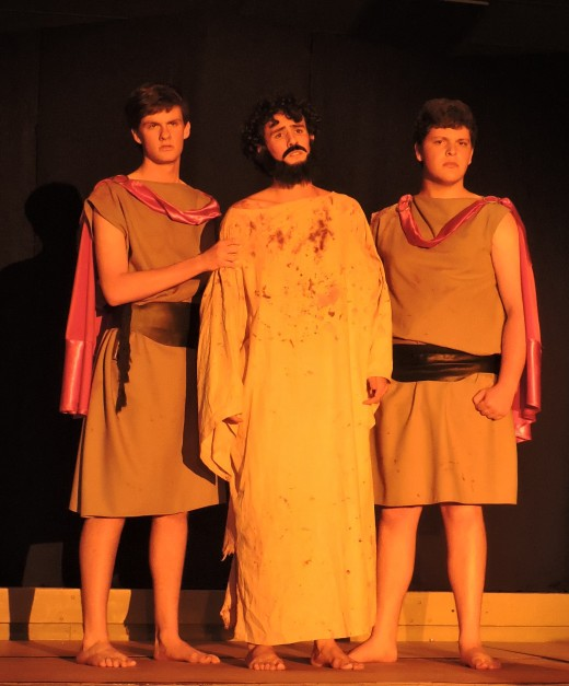 Jesus prepares to be scourged by Roman Soldiers.
