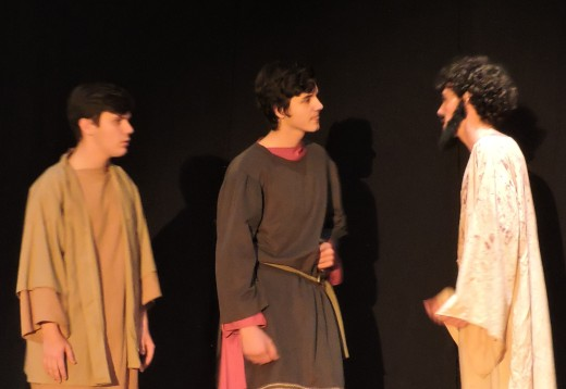 Jesus (Spenser Albright) converses with his disciples (Addison Nick and Shane Davies) after praying in the garden.