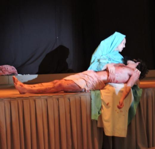 Mary (Emily Rulie) cradles Jesus (Spencer Albright) during the Pieta.