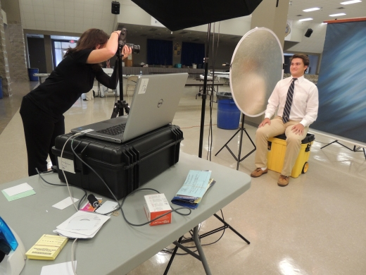 Senior Evan Esquerre takes his final school photo on Monday, Aug. 8, during Religion IV class. (photo: Mimi Monteiro)