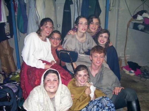 Scheuermann, at bottom left, gets ready for a performance of Les Miserables as a Marian Player in 2006. To her right is former teacher Jason Schroeder.