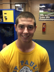 Two weeks into the new school year, freshman football player Thomas Bourgeois' hair is slowly returning. (photo: Spencer Fox)