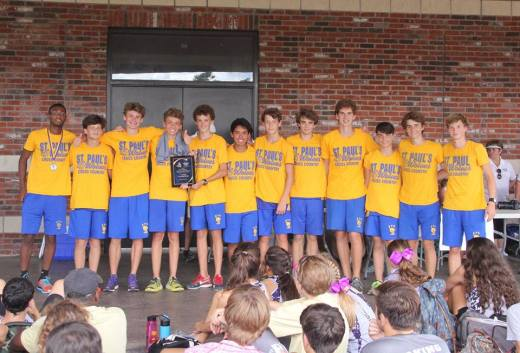 The Cross Country Wolves collect their first place award at the season opener. (photo courtesy Cross Country Wolves)