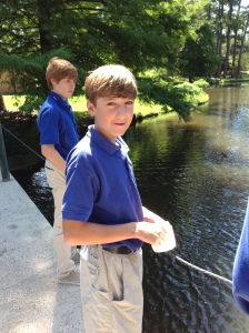 SPS student Julien Borel has fun at the pond. (Photo by Tyler Petro)