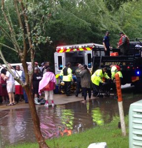 An ambulance tends to victims in the wake of the flood. (Photo by Landon Chambliss)
