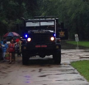 A police rescue truck prepares to venture into the flood waters. (Photo by Landon Chambliss)