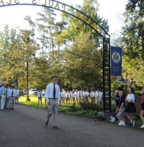 Legacy senior Spencer Cole, son of 1985 alumnus Ernie Cole, marches through the arch and down De La Salle Drive amidst family and the SPS student body. (photo by Danielle Lavie)