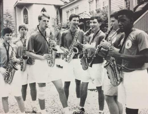 Chad Danenhower (center) along with the rest of the sax section warms up before a show. (photo: Conifer, 1992)