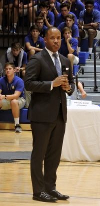 U.S. Attorney Kenneth Polite addresses the student body in the new gym regarding the dangers of opiod abuse. (Photo by: Karen Hebert)