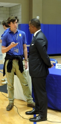 U.S. Attorney Kenneth Polite is interviewed by Luc Hebert after he spoke at St. Paul's. (Photo by: Karen Hebert)