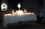 The Eucharist is presented to adorers in the Briggs Assembly Center.