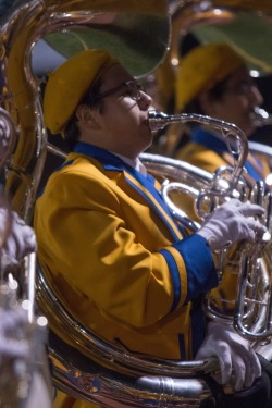"""Tuba section leader Cameron Holmes """"warms up"""" along with the remaining members of his section. (Photo by John Meyers)"""